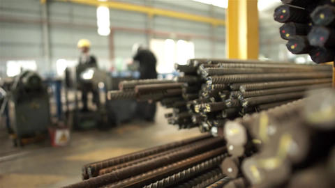 Workers Cutting Bundles Of Steel Bars - Slider - Focus Pull Live Action