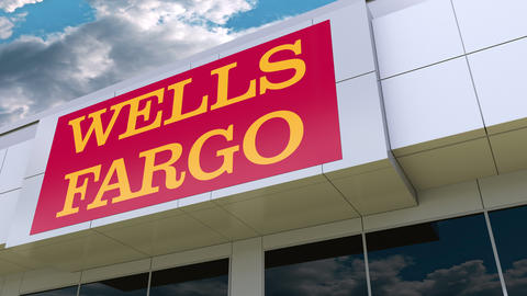 Wells Fargo logo on the modern building facade. Editorial 3D rendering Live Action