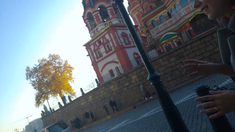 A young girl walks along the Red Square ビデオ
