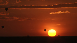 Hot air balloons and the rising sun Footage