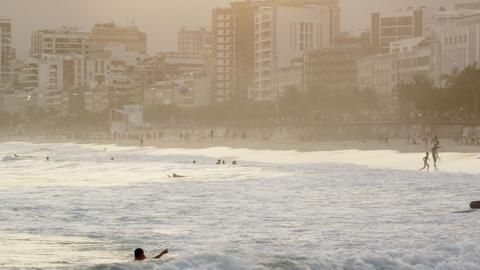 Waves crashing knocking people down Footage