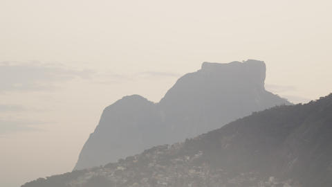 Pan shot of mountain and houses in Rio de Janeiro, Brazil Footage