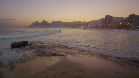 Slow motion shot of waves hitting Ipanema beach at sunset Footage