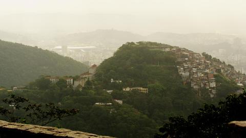Tilting footage of Rio hills, homes, Maracanã stadium Footage