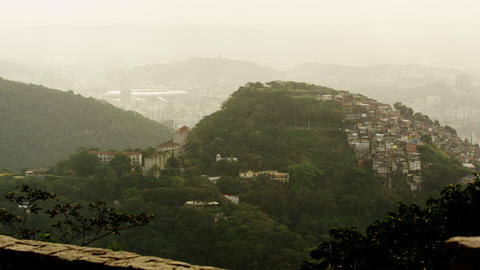 Tilting footage of Rio hills, homes, Maracanã stadium Live Action