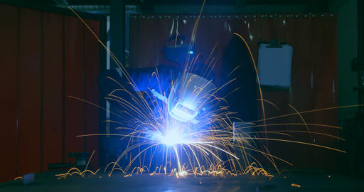 Time lapse of workers using welding torch in workshop 4k Live Action