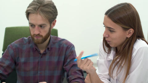 Man and woman work in comfortable modern office discussing close up. Working Footage
