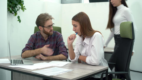 Man and woman work in comfortable modern office with laptop at the table Footage