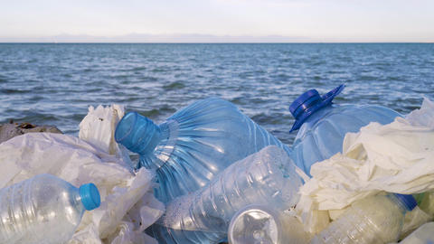 Pollution: garbages, plastic, and wastes on the beach after winter storms Footage