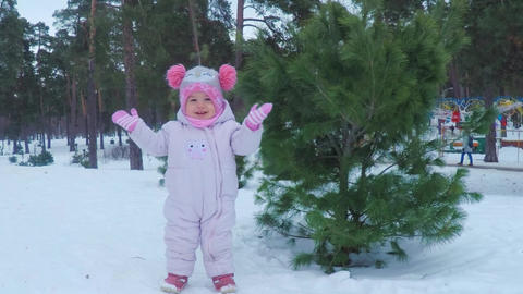 Little girl in the winter forest makes pikabu and smiles Stock Video Footage