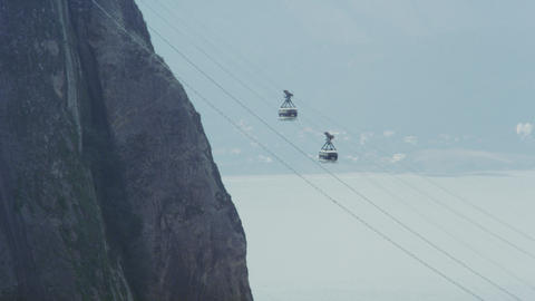 Static shot of cable cars going up Sugarloaf mountain in Rio De Janeiro Footage