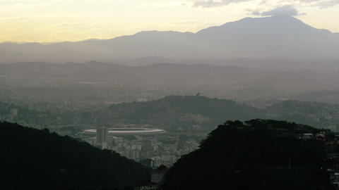 Still distance view of the hills and mountains rising up over the cityscape in R Footage