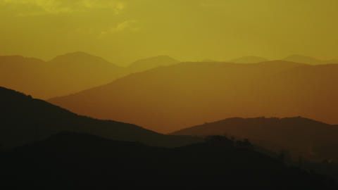 Pan of mountain silhouette against orange sky in Rio de Janeiro Footage