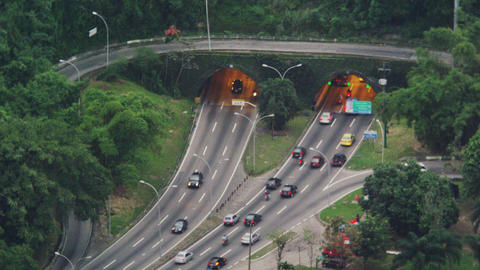 High-angle shot of traffic entering and exiting tunnels Footage