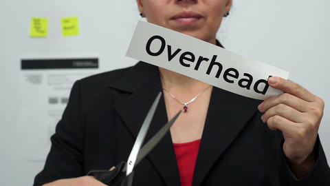 Businesswoman Cuts Overhead Concept stock footage