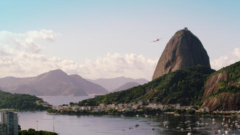 Static, high definition, shot of an airplane flying over Guanabara Bay - Rio de  Footage