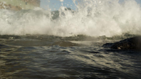 Static shot of the Atlantic ocean breaking into rocks and camera Footage