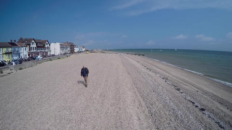 Walk on the beach in England Live Action