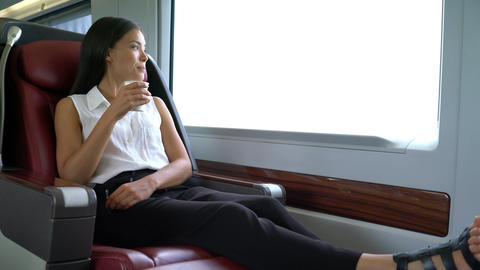 Asian woman commuter in train drinking morning coffee on... Stock Video Footage