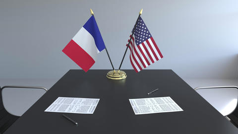Flags of France and the United States of America and papers on the table Live Action