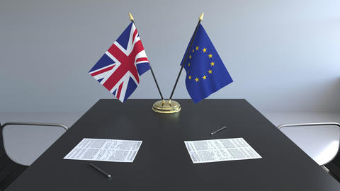 Flags of Great Britain and the European Union and papers on the table Footage