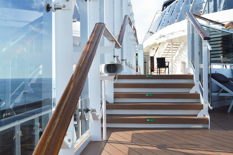 View of the wooden stairs on the open deck of a luxury cruise liner Photo