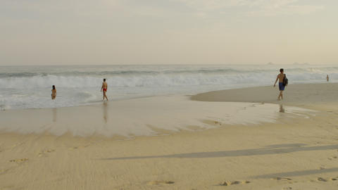 Static shot of a sparse gathering of people on Ipanema beach Footage