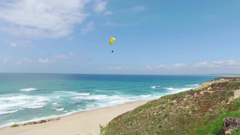 Paragliders Fly Over the Ocean Beach Live Action