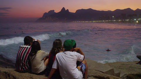 RIO DE JANEIRO-JUNE 16: People watching ocean waves at sunset on June 16, 2013 i Footage