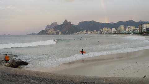 Pan shot of the beach bellow the rest area at Ipanema Beach in Rio de Janeiro Footage