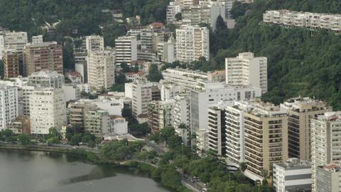 Aerial pan of lakeside buildings Footage