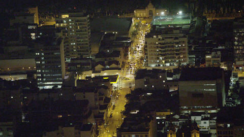 A busy road on a city block at night in Rio de Janeiro Footage