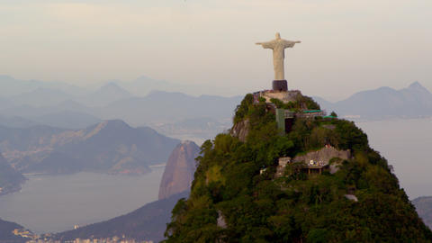 Aerial tracking footage of Christ Redentor overlooking bay, mountains Footage