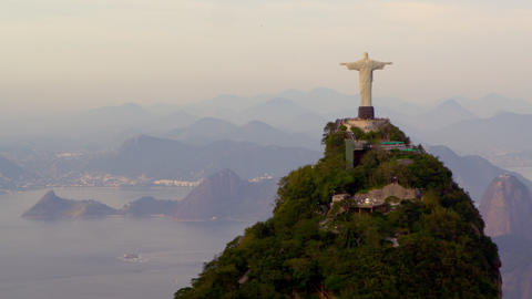 Aerial tracking footage of Christ Redentor overlooking bay Footage