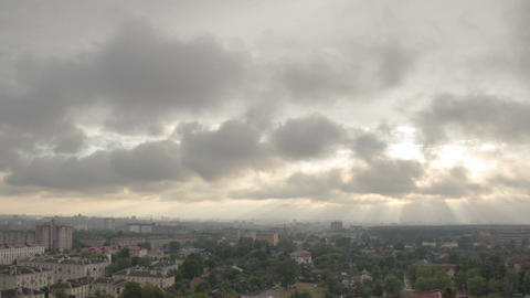 Storm clouds moving above city time lapse Footage