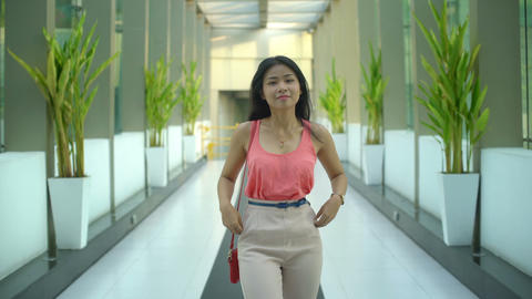 Happy young Thai girl is stands in the office building Footage
