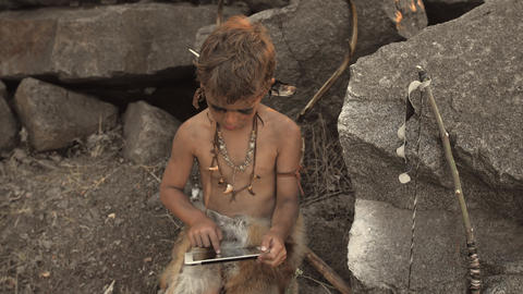 Caveman, manly boy making using tablet PC Live Action