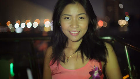 Portrait of Thai girl on a boat in night city river Footage