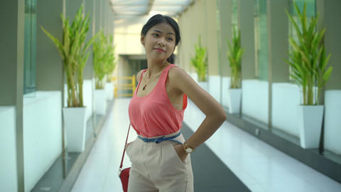 Happy young Asian woman is posing in the office Footage