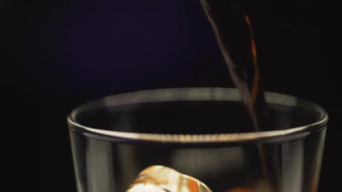 pour the cola from bottle to glass , fresh drinking ,... Stock Video Footage