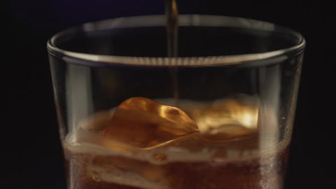 pour the cola from bottle to glass , fresh drinking , drinking soda. Coca Cola Footage