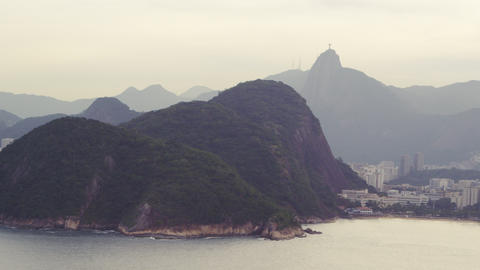 Aerial shot of mountains and buildings along the beach in Rio de Janeiro, Brazil Footage