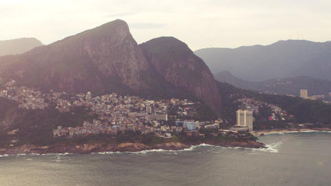 Aerial pan shot of favelas on the mountain and the city of Rio de Janeiro, Brazi Footage
