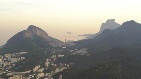 Aerial shot of Rio de Janeiro, Brazil amidst mountains Live Action