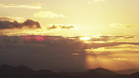 Downward panning shot of sunset on hills in Rio de Janeiro Footage