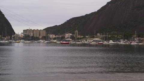 Shot of boats along the Rio de Janeiro coastline in Brazil Footage