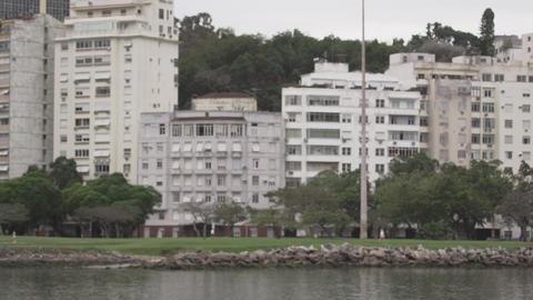 Panning shot of a community along the shoreline in Rio de Janeiro, Brazil Footage