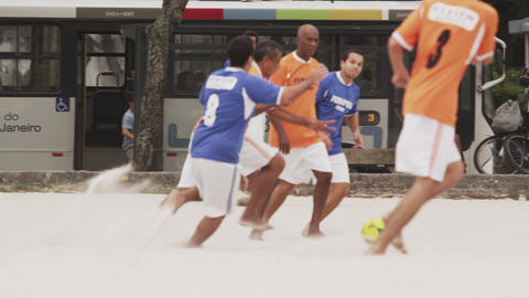 RIO DE JANEIRO, BRAZIL - JUNE 23: Slow motion pan - playing soccer on June 23, 2 Live Action