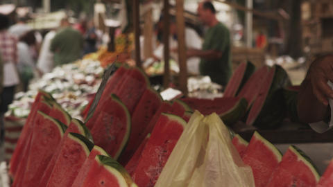 RIO DE JANEIRO, BRAZIL - JUNE 23: Buying watermelons at a market on June 23, 201 Footage
