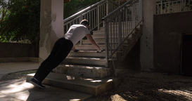 Man doing push ups at the outdoor staircase Footage